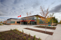 Exterior of a modern school with Canada flag in front