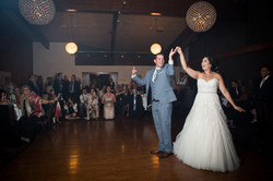 Bride and groom having a fun dance while guests look on in the background