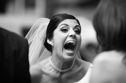 Bride enthusiastically greeting her guests