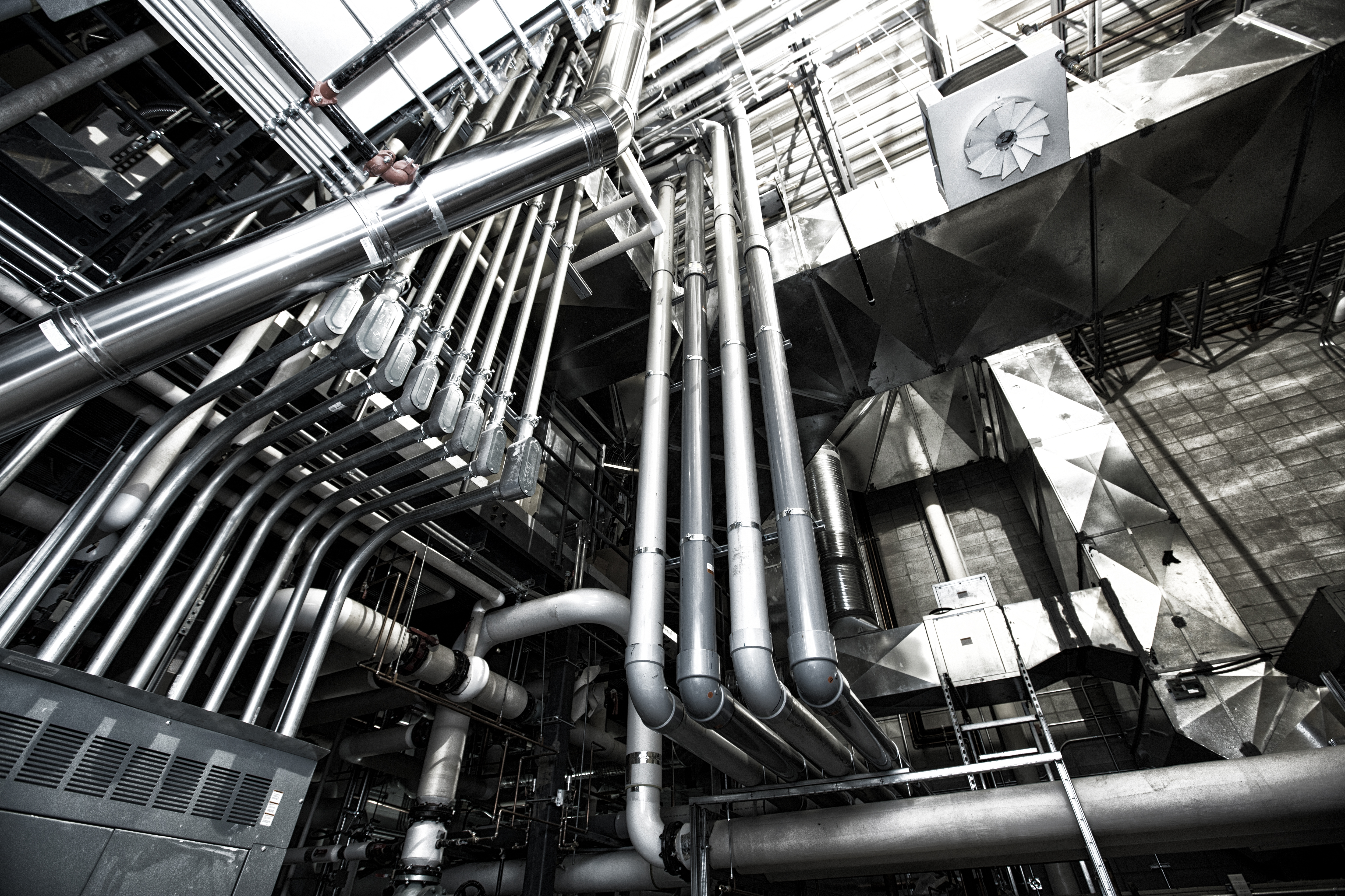 Close up of pipes in a large boiler room