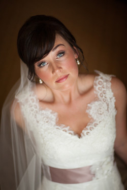 Pretty blue eyed bride looking up toward camera