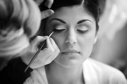 Bride getting eye make up applied