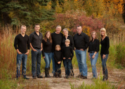 Extended family of ten standing together in a park