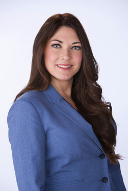 Business woman in blue suit with long dark hair