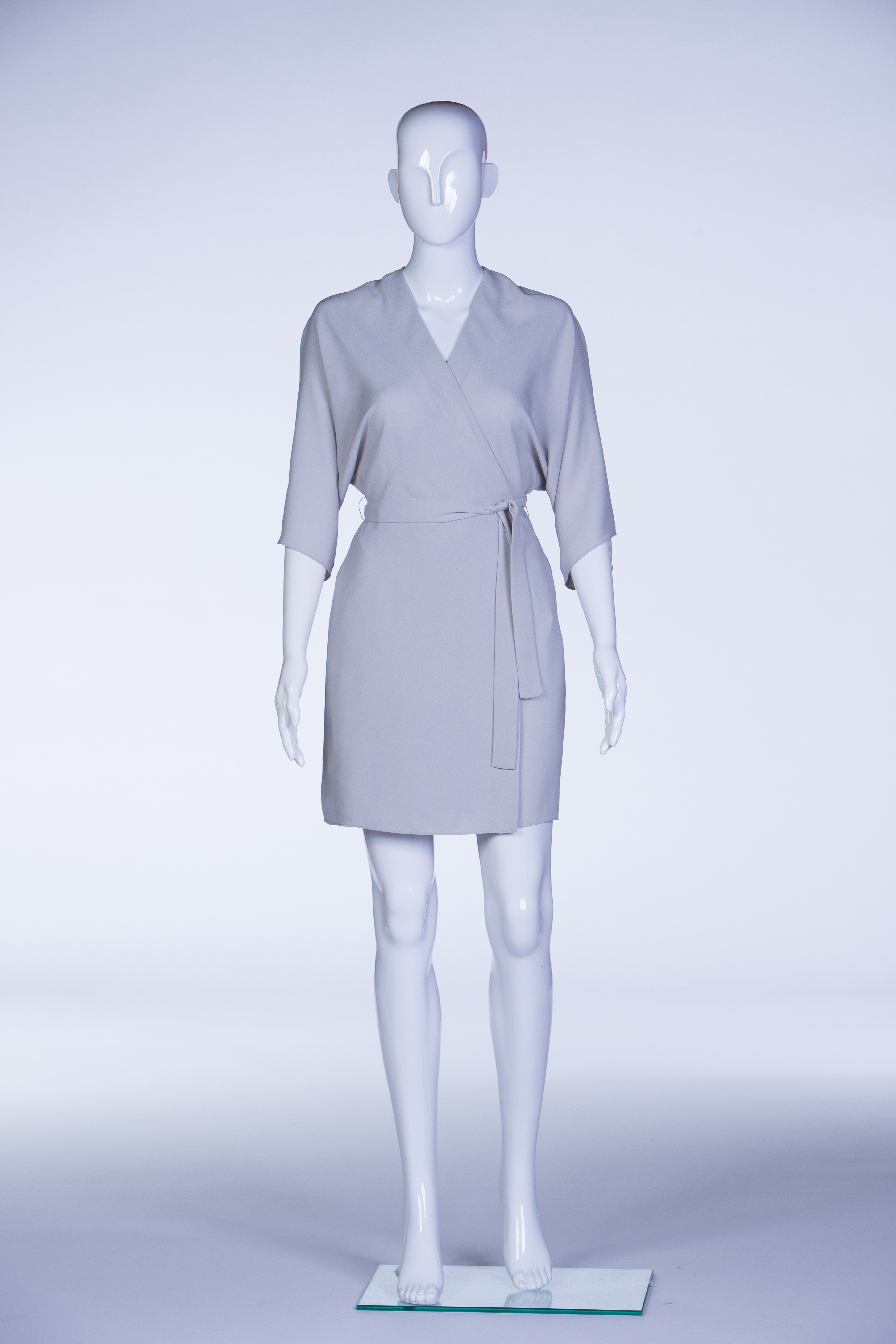 Mannequin wearing a grey dress