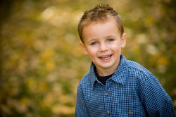 Young boy in blue smiling
