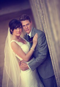 Bride and groom looking toward camera