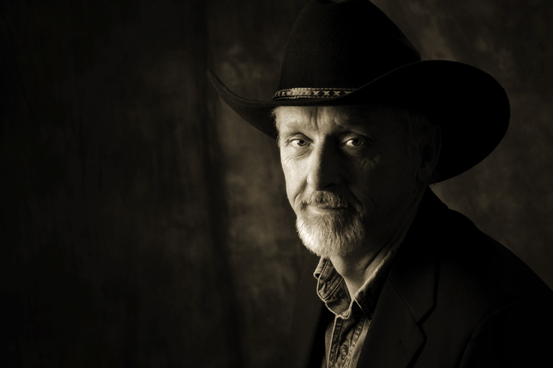 Older bearded man wearing a cowboy hat