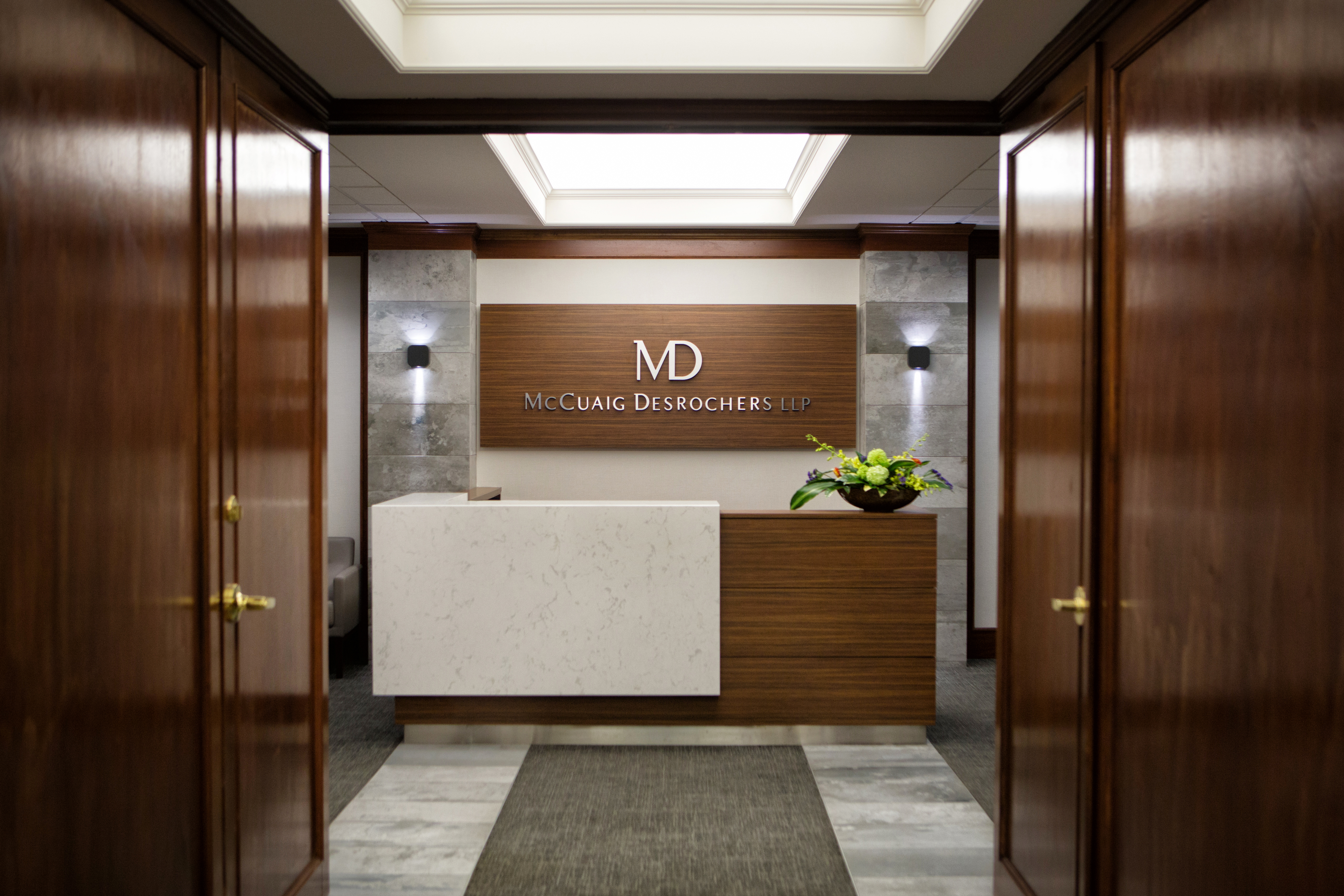 Reception desk of law firm with logo on wall