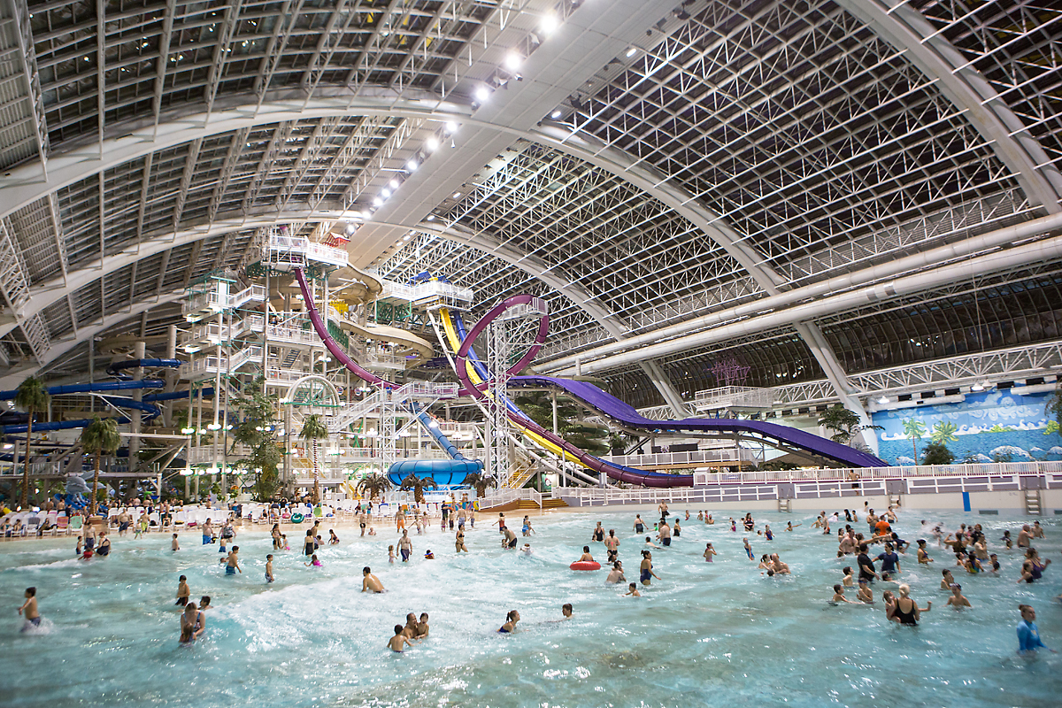 Indoor waterpark with people splashing around