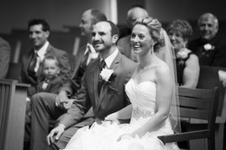 Bride and groom sitting side by side smiling