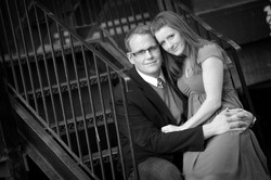Engaged couple sitting together on a stairwell