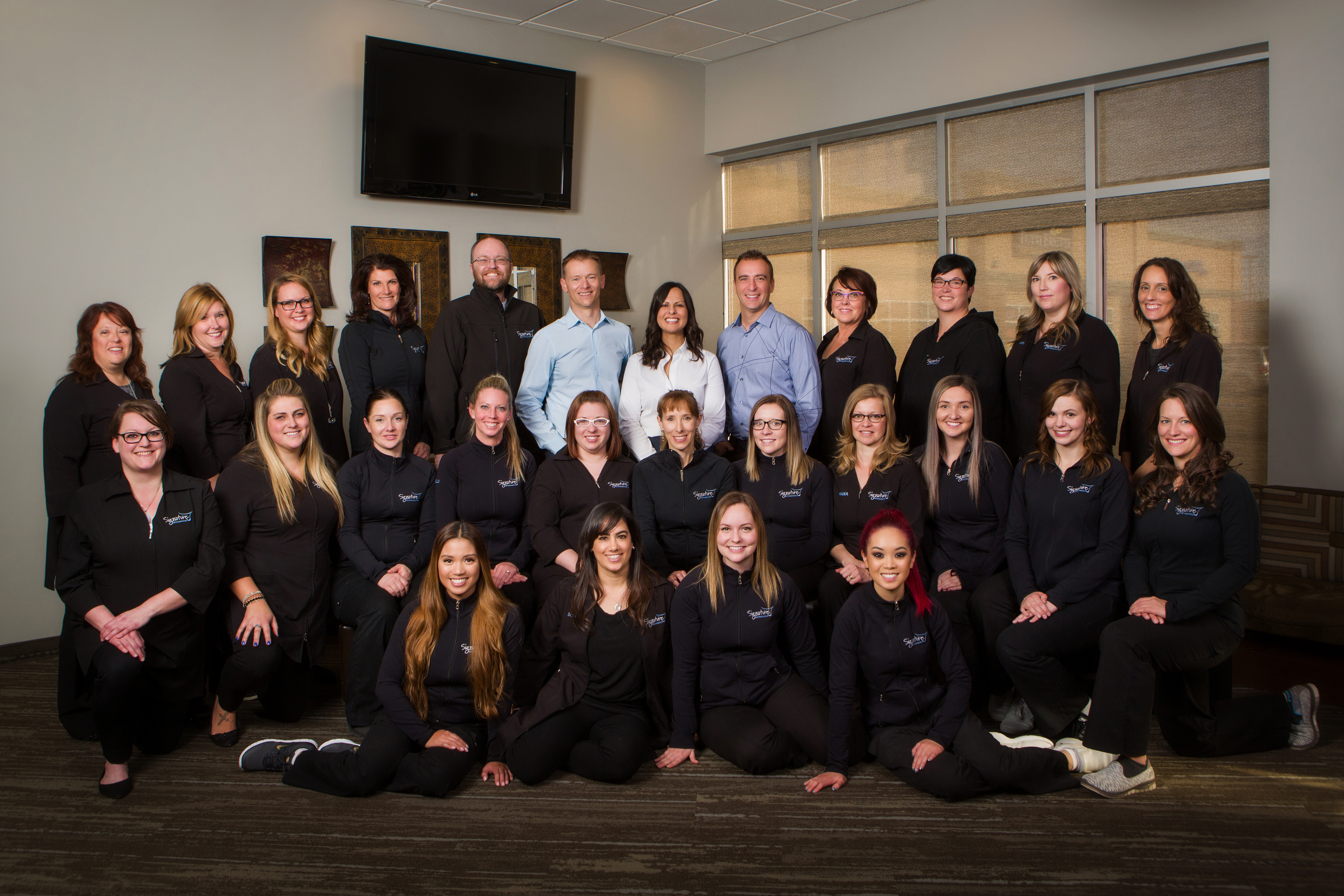 Large team of staff at orthodondist office