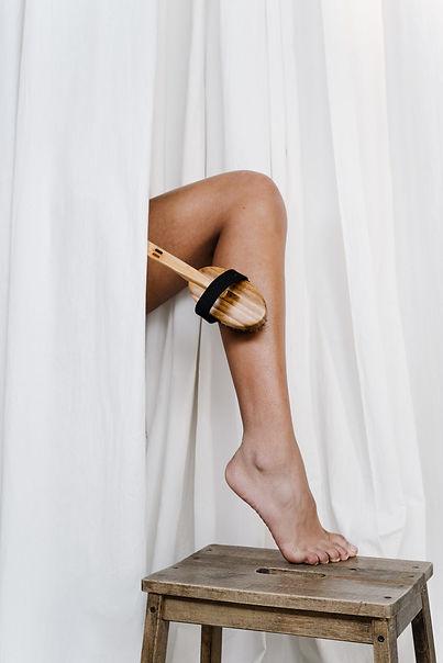 person-scrubbing-her-leg-3737825.jpg