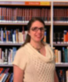 z. Nishoni in front of bookcase.jpg