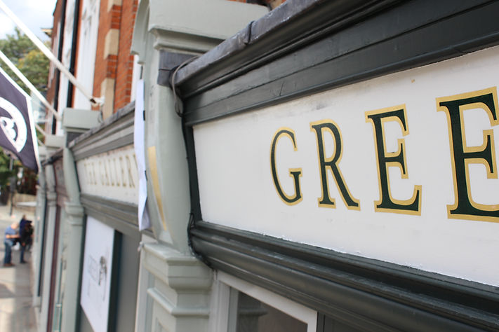 hand painted and gilded in green and gold shop front fascia for art gallery and shop