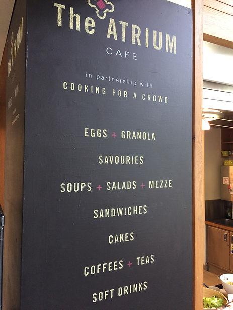 Hand written coloured chalk menu board for cafe