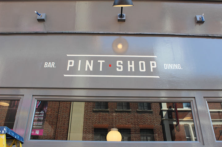 hand painted fascia with bar name and logo