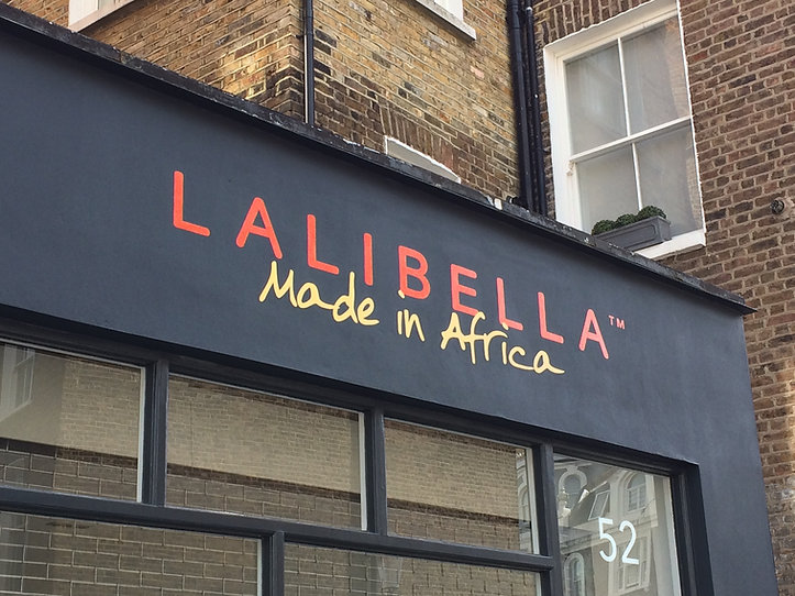 hand painted shop front fascia with shop name