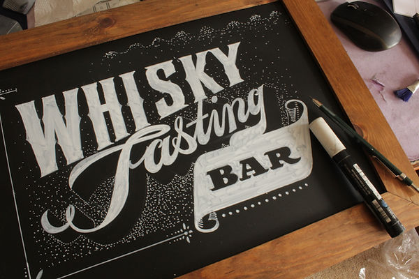 Hand drawn sign in posca pen for bar