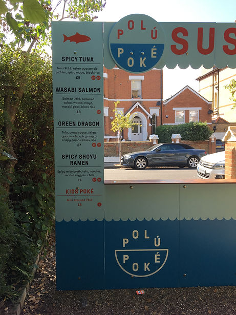 painted food stall front with logo and menu panels for events