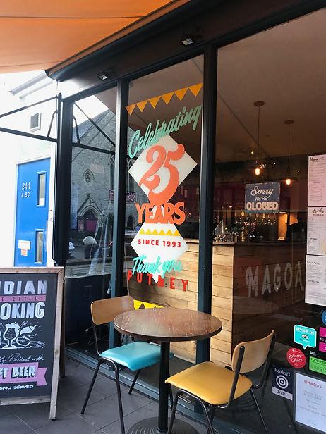 hand painted colourful window splash for restaurant celebrating 25 years