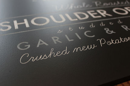 close up of hand written chalk menu boards for event