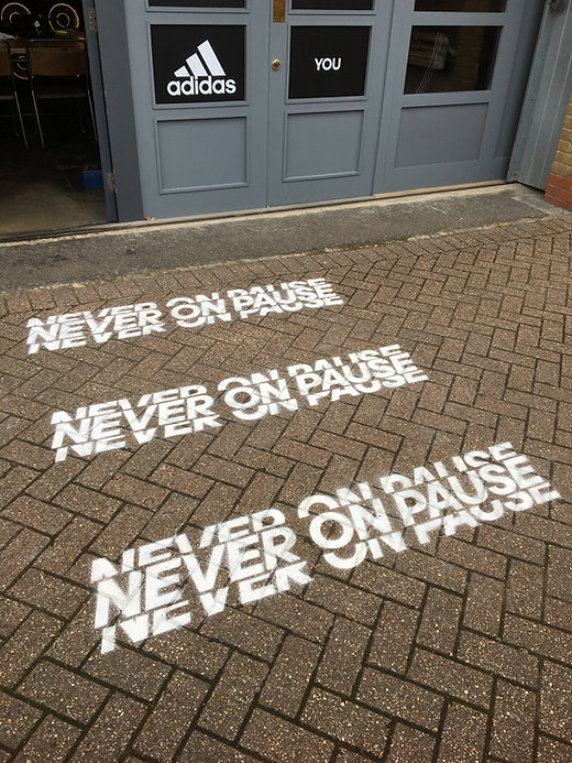 spray painted floor stencil with company branding message for event