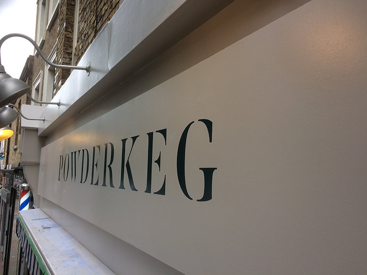 hand painted shop front fascia sign for shop