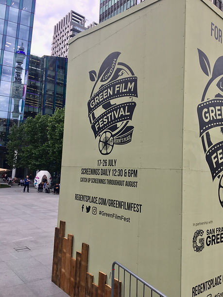 painted event logo and timings for film festival on built external screen