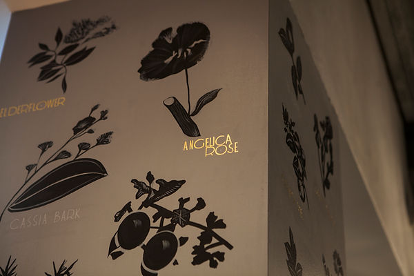 hand painted botanicals with gilded lettering for bar