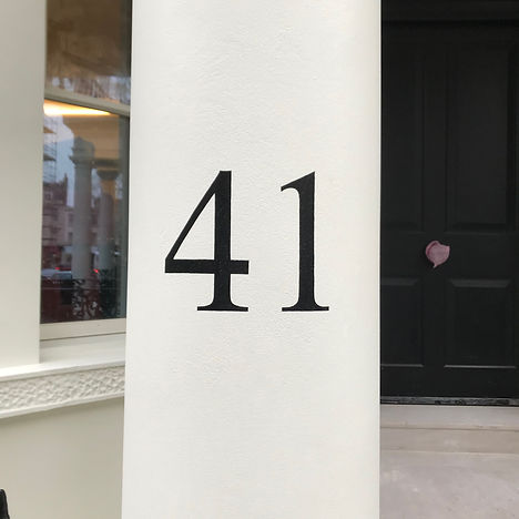 hand painted 41 house number on pillars outside front door