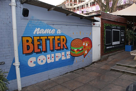 colourful mural for bar courtyard with lettering