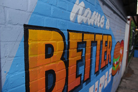close up of colourful mural for bar courtyard with lettering