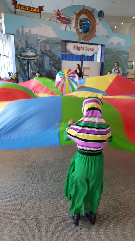 playingwithblanketparachute.jpg