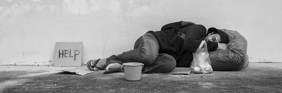 Homeless person sleep on sidewalk of the