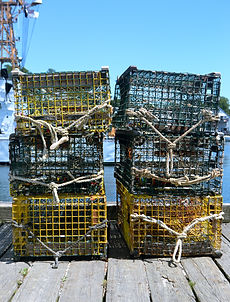 Lobster traps sitting on a fishing dock