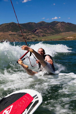Surfing behind our boat at East Canyon Reservoir in Utah