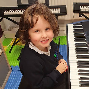Oliver - _I just love my piano lessons!_
