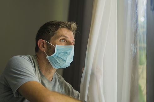 coronavirus man in mask at home - FLIPPE