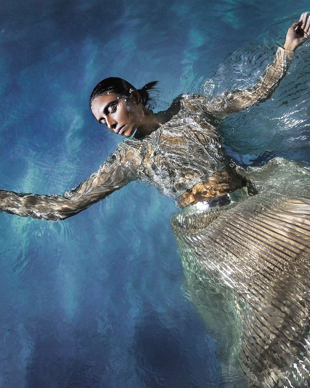 illusions underwater for Aggarwal's fashion film