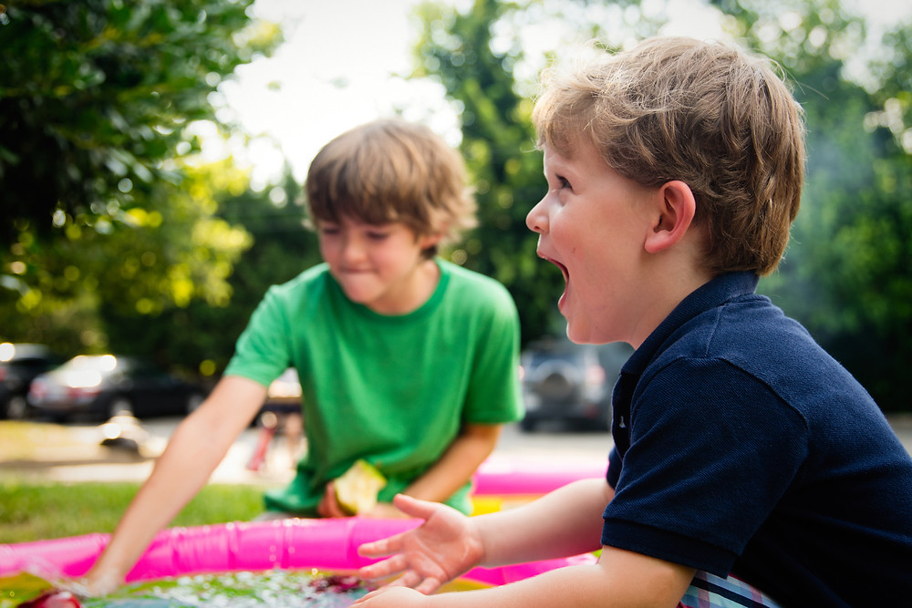 two kids having fun at the park during the summer