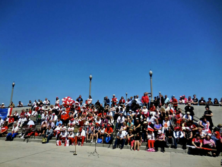 The stairs in Grant Park are being used as an amphitheater to watch the Polish Constitution Day Conc