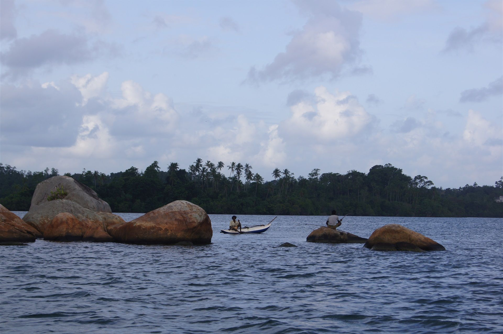Take a boat to the rocks on Koggala
