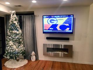 606 Installs   Mounted TV, soundbar, & fireplace