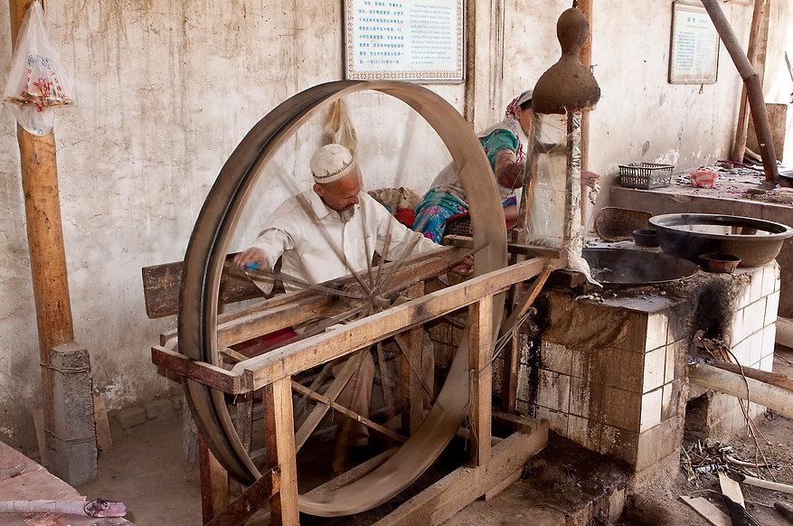 old carpanter making cart wheel