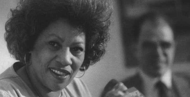 Toni Morrison speaks at the University at Albany in 1984, with Writers Institute founder William Kennedy in the background at right. (Albany Times Union file photo)