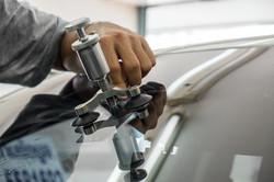 Mechanic using repairing equipment to fi