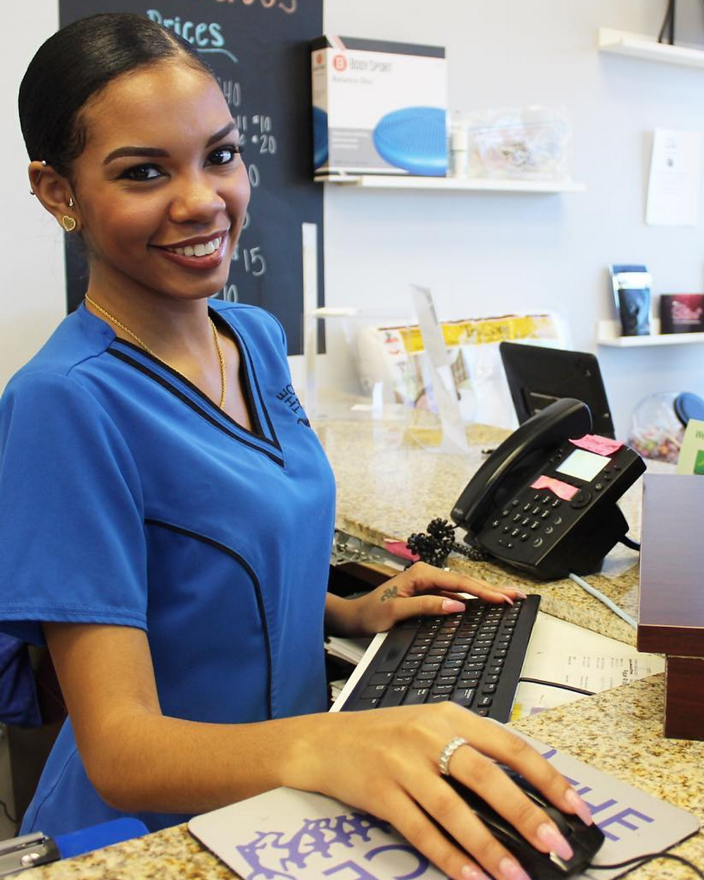 smiling woman in The Chiro Place uniform