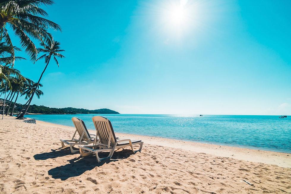 beautiful-tropical-beach-sea-with-chair-